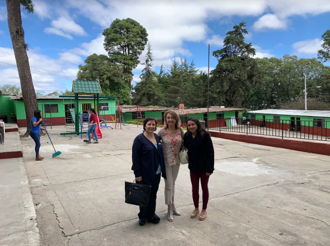 Pediatric Therapeutic Services co-founder and co-managing partner Pam Hackett poses with ______Karla de Pineda, Edify Director, and Principal Yadira Arriaza at Agua Viva (Living Water) school in Guatemala.